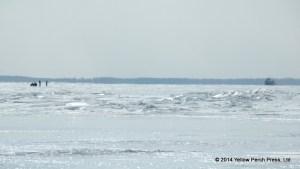 ATV riders on frozen Lake Erie
