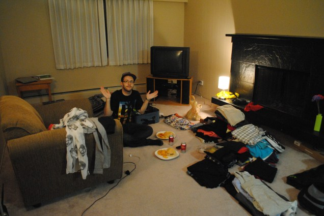 Dinner on the floor and surrounded by clothes to pack!