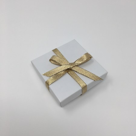 gold and white, jewelry box, gold ribbon, jewelry box tied with ribbon, gift wrap
