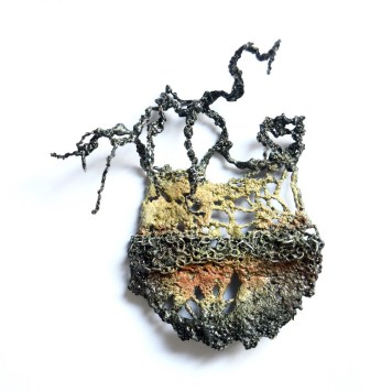 Liana Pattihis, brooch ''In the palm of your hand'' - various silverchains, enamel, stainless steel