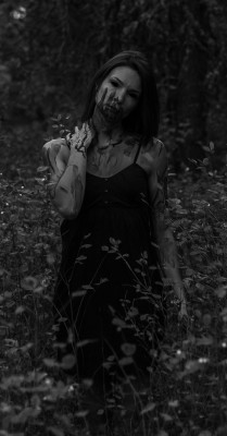 Vampire woman walking through the forest