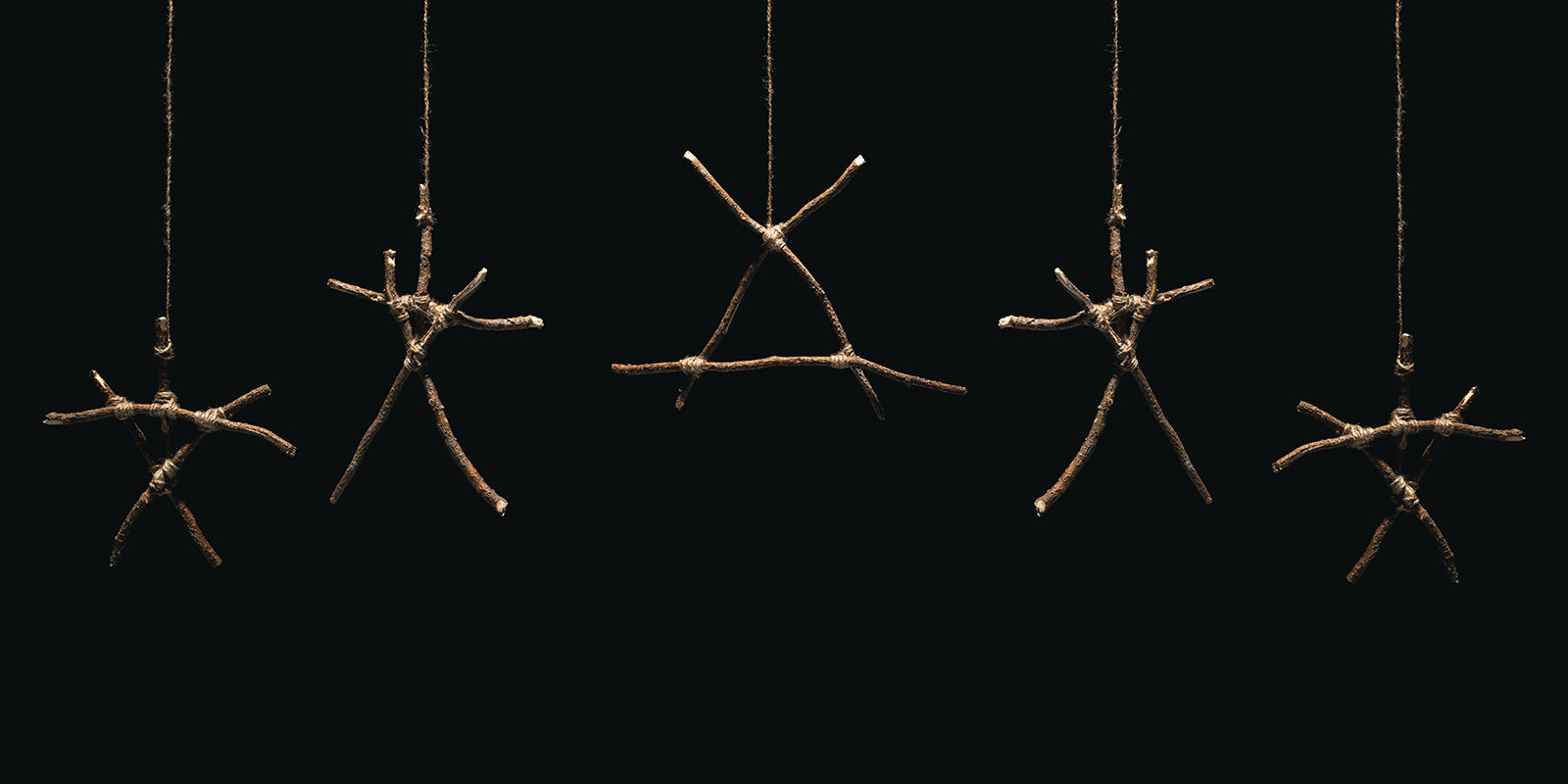 occult or witchcraft folk horror symbols made from sticks.