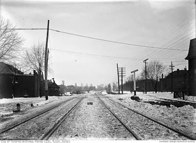 1911 Feb.9, 1911 - looking west along Grand Trunk railway from east of Dunn Foreground far right edge of the Dunn Milk _tn