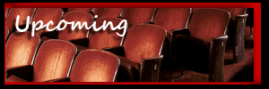 Upcoming - empty red velvet theater seats