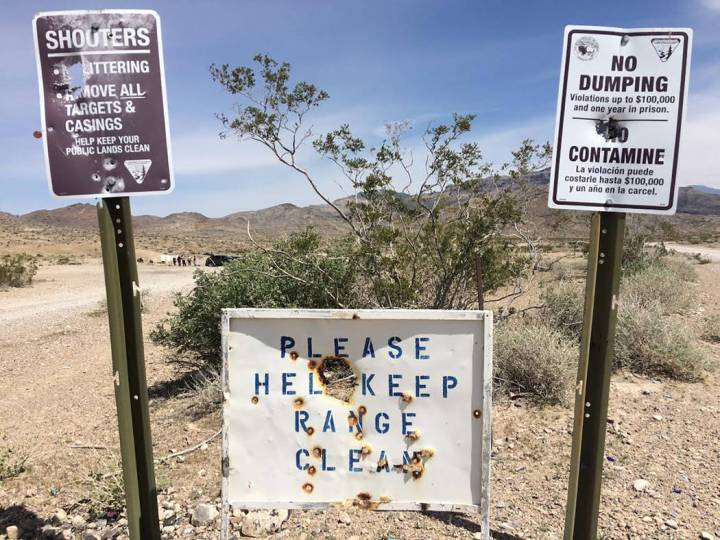 Robin Hebrock/Pahrump Valley Times These signs, located at the entrance to the area off Bell Vista Road where residents commonly shoot their firearms, bare numerous bullet holes. The area is not m ...