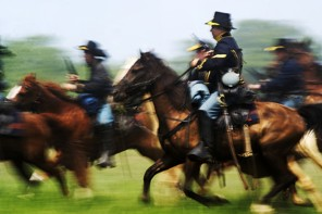 Charging the battlefield at Bull Run during the 2011 reenactment of First Manassas. Preservationists believe land outside the park's boundaries, where actual battles were fought, would be paved over by the Tri-County Parkway. (Amanda Voisard - The Washington Post)