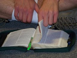 picture of a student reading his Bible