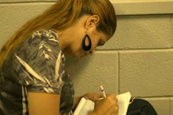 picture of a student writing in her journal