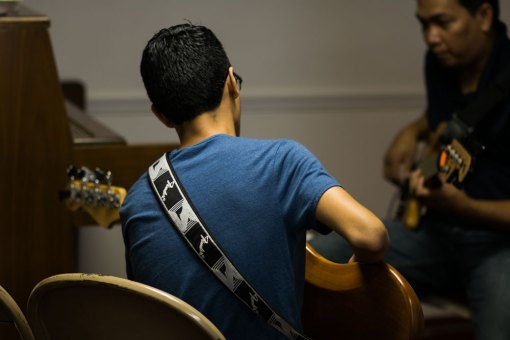 picture of a teacher with a bass guitar student