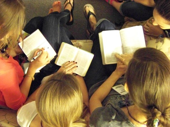 picture of a group of students reading their Bibles