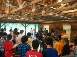 A multicultural worship team leading a multicultural youth gathering