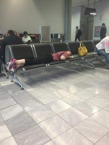 Rachael sleeping in the airport.