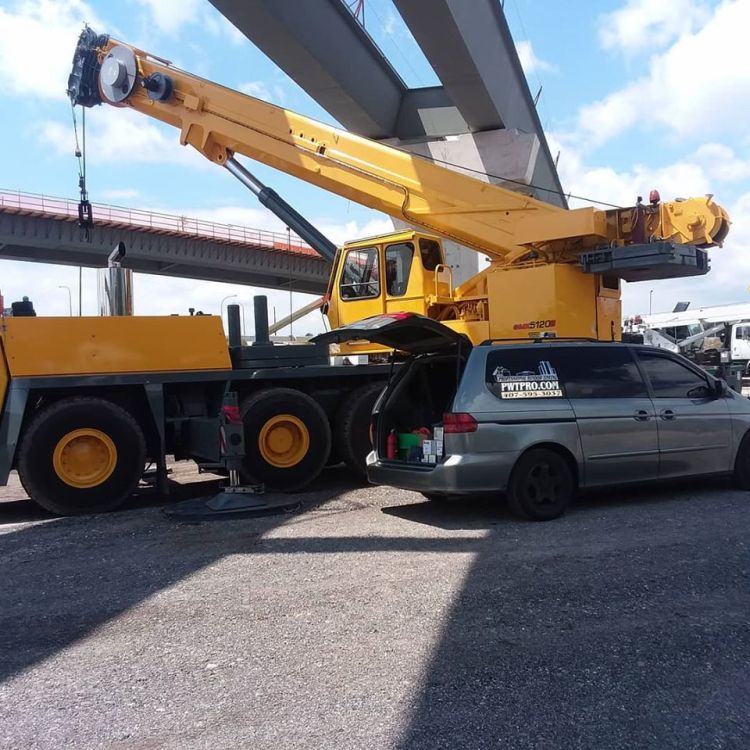 Tinting a crane on a job site. Professional Window Tinting of Central FL LLC