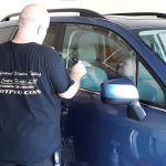 Installing ceramic window film on a car in Oviedo