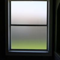 Residential Decorative frost window film on bathroom home window. Professional Window Tinting of Central FL LLC house
