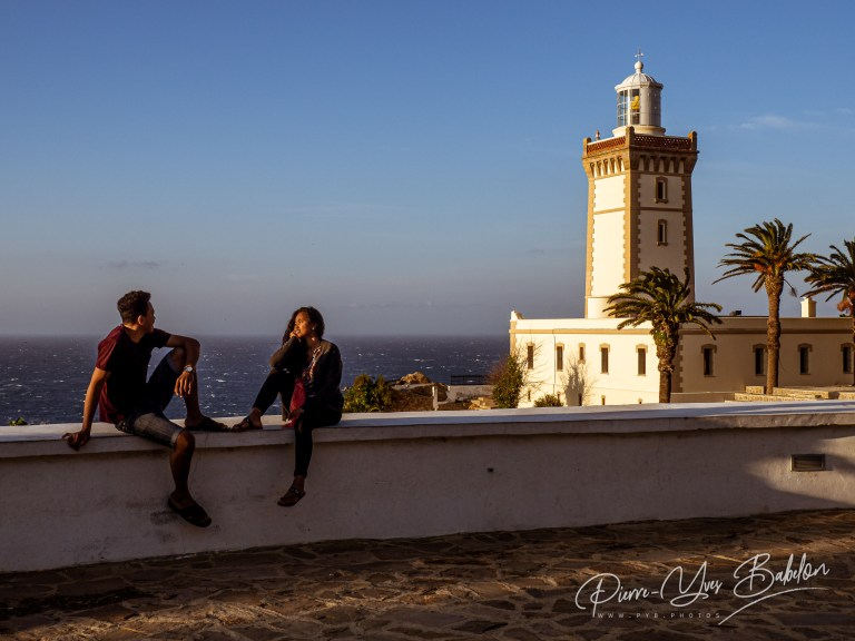 A couple sitting on the parapet of Cape Spartel lighthouse
