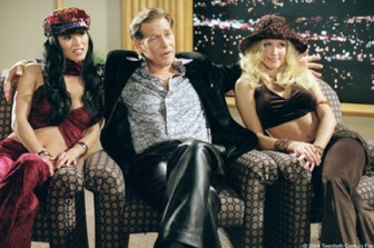Slick adult film producer Hugo Posh (James Remar) is flanked by two of his top stars: Ferrari (Sung Hi Lee) and April (Amanda Swisten).