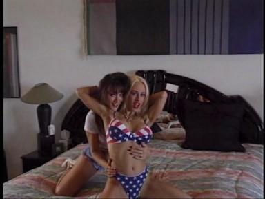 the patriotic blonde is Davia Ardell (b1975) , the brunette behind her is Taren Steele.