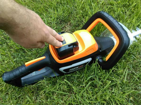 Battery inserted into TackLife Cordless Hedge Trimmer
