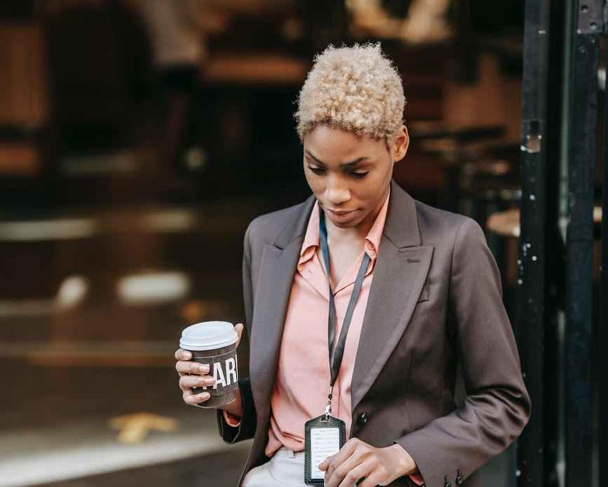 focused black businesswoman using laptop