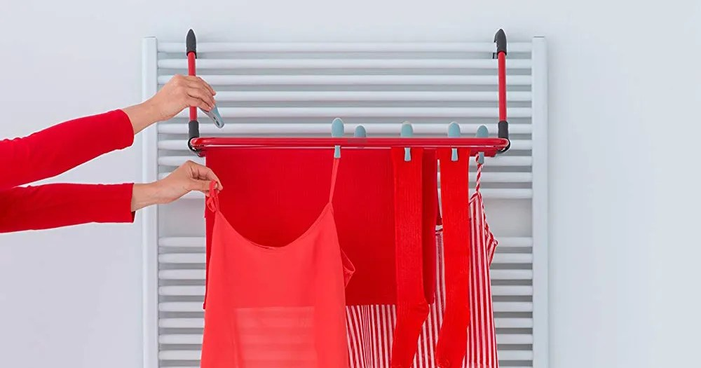 laundry day is a bit less chaotic thanks to this nifty over door drying rack