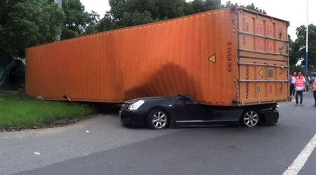 Chinese Driver Escapes Being Crushed By Giant Container