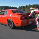Stuntman Skating Behind A Dodge Challenger SRT8