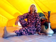 Mehmooda Shafi, 75, mother of three, sits in a tent at Hyderpora. She was brought here from Qamarwari area of Srinagar in a truck by locals, after her house was inundated.
