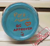 Bottom of the finished minion mug with official QC Approved branding! / QC APPROVED.