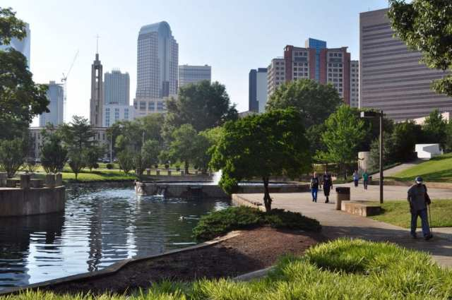 People walk though Marshall Park at sundown. Under a plan accepted Wednesday by county commissioners, much of the open space would give way to development. (Photo: Glenn H. Burkins)