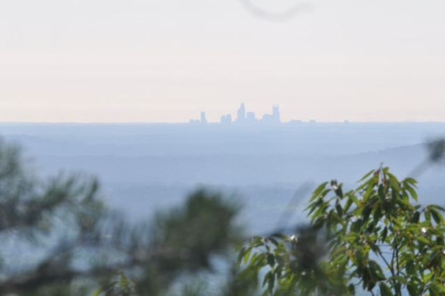 Thirty miles away, the Charlotte skyline is visible from the eastern slopes of The Pinnacle.