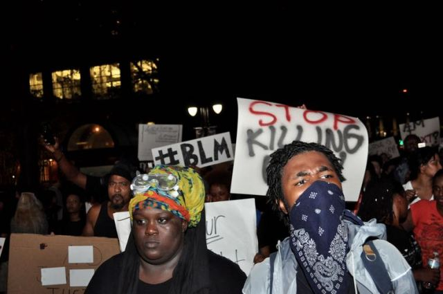 Protesters march through the streets of uptown Charlotte three days after a Charlotte-Mecklenburg police officer shot and killed Keith Lamont Scott under disputed circumstances, Friday, Sept. 23, 2016. (Photo: Qcitymetro.com)