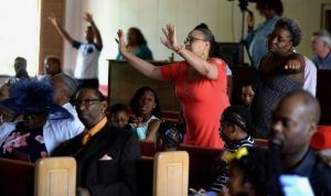 "People sing hymns during the Easter Service at The Creek Church which relaunched the church after a damaging 2015 arson fire. The Creek Church - formerly Briar Creek Baptist Church--celebrated Easter Sunday with an Easter egg hunt and a vision of ""healing, help, and hope."" Diedra Laird, The Charlotte Observer"