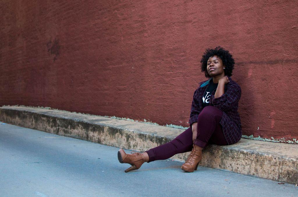black-woman-sitting-on-sidewalk-curb