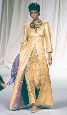 CHRISTY TURLINGTON Turlington, now 48, is a golden goddess at the Valentino Haute Couture Fall/Winter 1991-1992 fashion show in Paris. © Victor VIRGILE/Gamma-Rapho/Getty