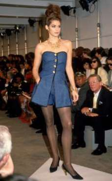 CINDY CRAWFORD Feeling blue! Crawford, now 51, strikes a pose at a 1991 Donna Karan fashion show. © Barbara Rosen/IMAGES/Getty