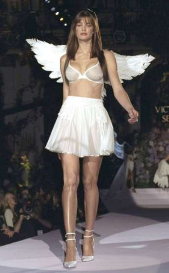 STEPHANIE SEYMOUR Seymour, now 49, gets her wings during a Victoria's Secret Fashion Show. © Richard Corkery/NY Daily News Archive/Getty