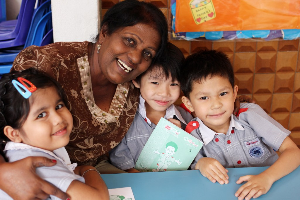 Children Hugging Teacher (2)