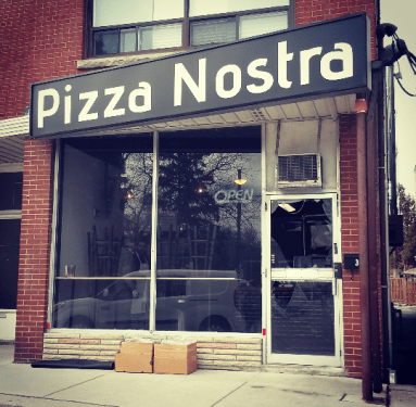 The glass door at Pizza Nostra at 362 Lakeshore Rd. W. was found shattered on Saturday, Feb. 20, 2016. (Photo: Kelly Roche/QEW South Post)