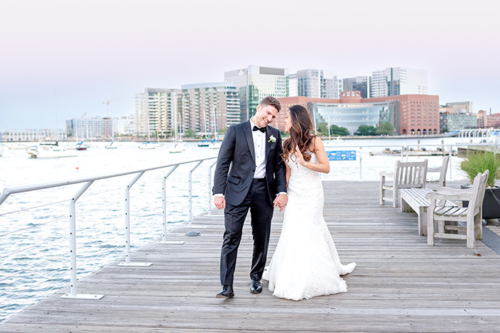 bride and groom boardwalk photo at New England Aquarium Q Hegarty Photography wedding photographer in Boston, MA