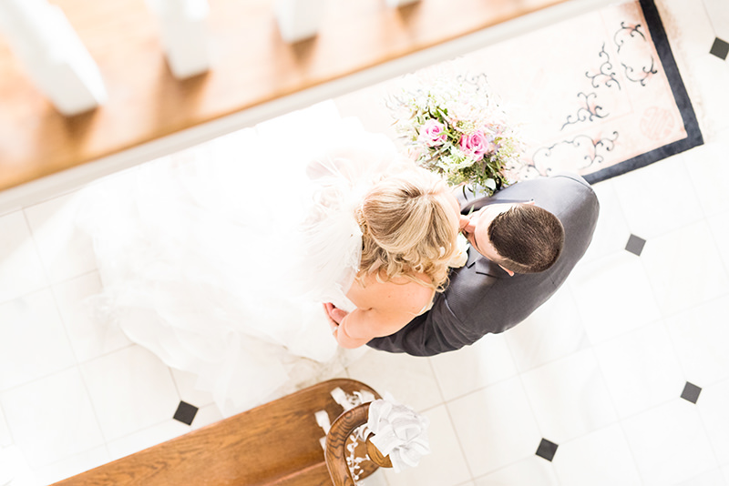 bride and groom first look in foyer Five Bridge Inn Rehoboth, MA Q Hegarty Photography weddings and portraits