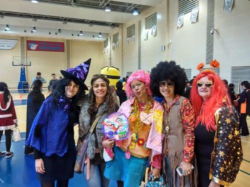 Expat mamas enjoying our kid's school Halloween