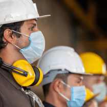Industrial workers wearing protective face masks