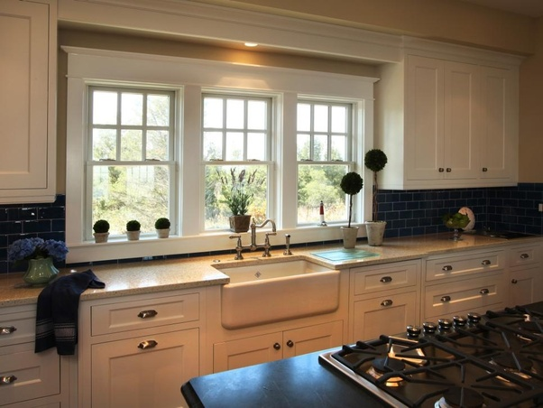 kitchens have the sink facing a window