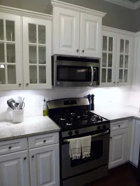 regular microwave oven over a stove