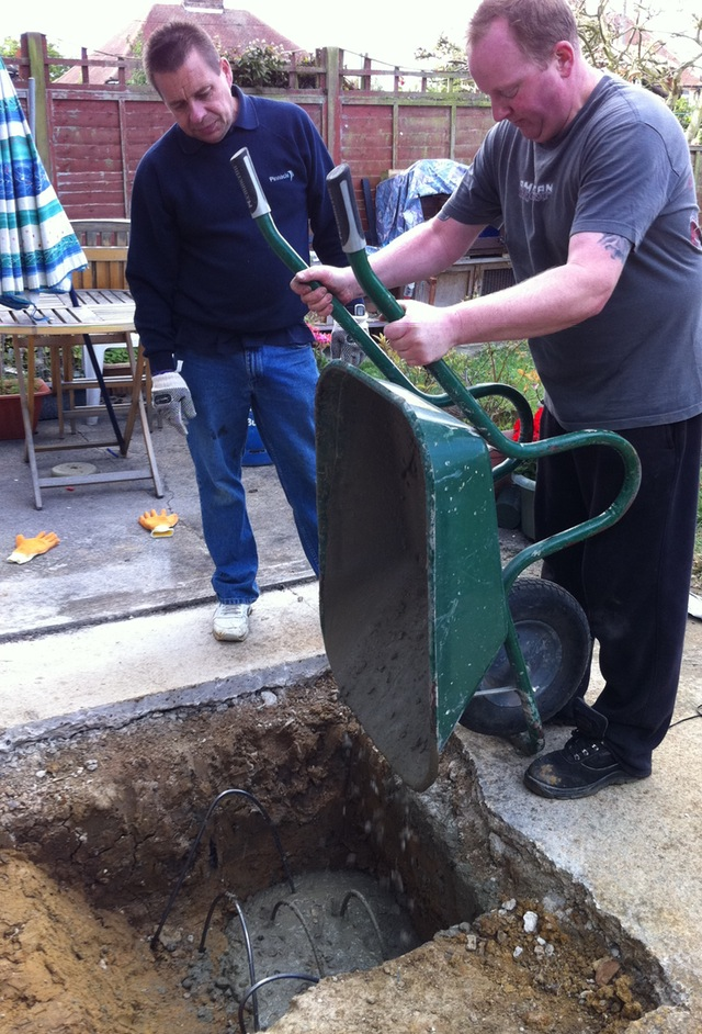The first load of concrete goes into the hole