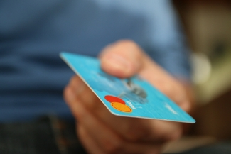 closeup of a person holding a credit card