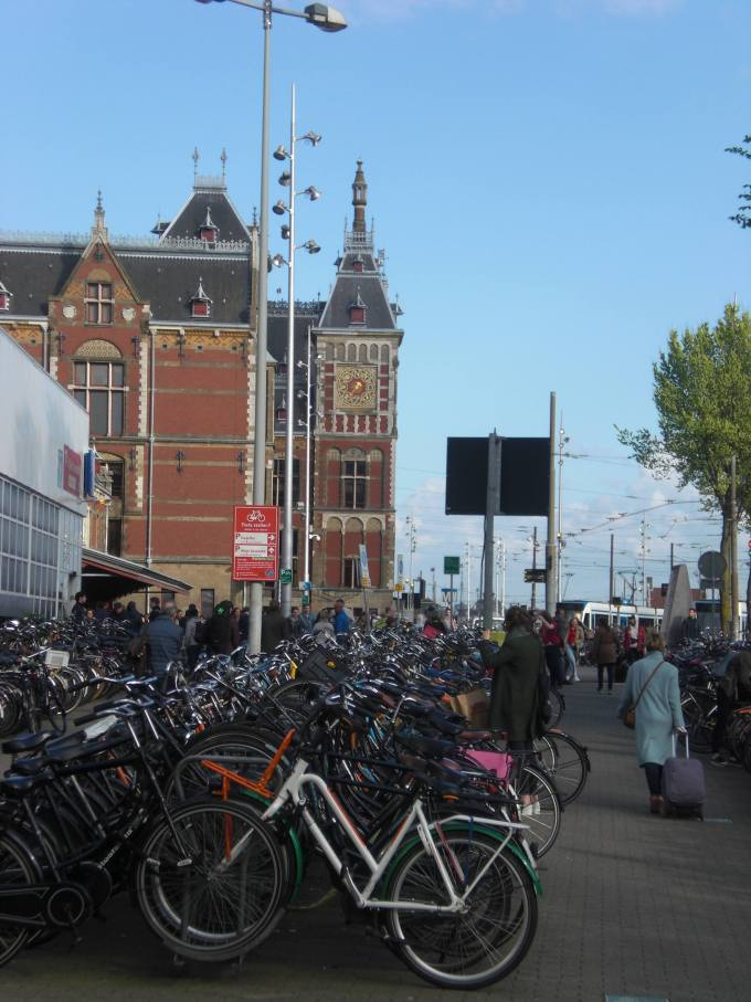 Amsterdam Central Station with lots of bikes in the foreground