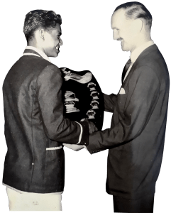 Sunil Fernando, captain of the 1964 St Benedict's Cricket team, receiving the Lifebuoy Shield for the Unbeaten Schools Champions from Unilevers (then Lever Brothers) Chairman. Sunil also took home the Best Captain of the Year award.