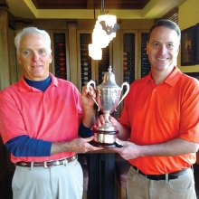 Quail Creek Golf Professional Joel Jaress presents 2014 Club Championship Trophy to Bob Ford.